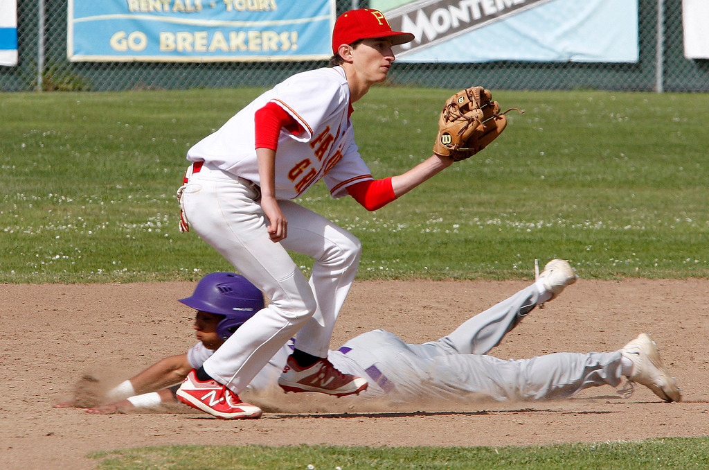 . Soledad High School\'s Aaron Rodriguez (8) slides under the tag of Pacific Grove High School\'s Jackson Destefano (4) safely into second base during their game in Pacific Grove on Thursday, May 10, 2018.  (Vern Fisher - Monterey Herald)