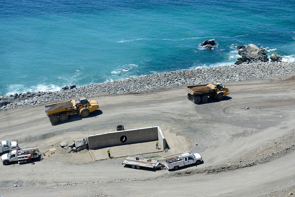. Heavy equipment work continues near the revetment wall at the base of the Mud Creek slide on Monday, May 7, 2018.  (Vern Fisher - Monterey Herald)