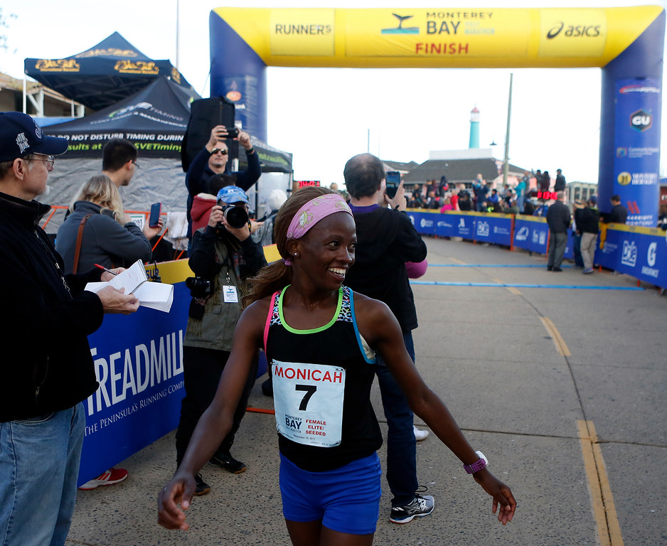 . Monicah Ngige of Kenya reacts after winning the Monterey Bay Half Marathon in Monterey, Calif. on Sunday November 12, 2017. (David Royal/Herald Correspondent)