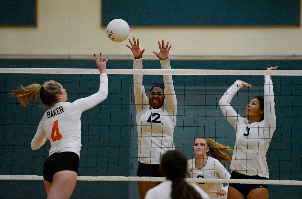 . Woodland\'s Jessica Baker (4) against Santa Catalina\'s Maria Santos (12) and Kia Shoemaker (3) during their CIF State Girls Volleyball Championships - Division III at Santa Catalina School in Monterey on Wednesday, Nov. 15, 2017.  (Vern Fisher - Monterey Herald)