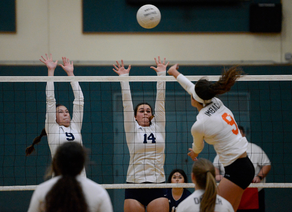 . Santa Catalina\'s Jessica Clements (9) and Alicia Rector (14) go up to block the shot of Woodland\'s Megan Imbach (9) during their CIF State Girls Volleyball Championships - Division III at Santa Catalina School in Monterey on Wednesday, Nov. 15, 2017.  (Vern Fisher - Monterey Herald)