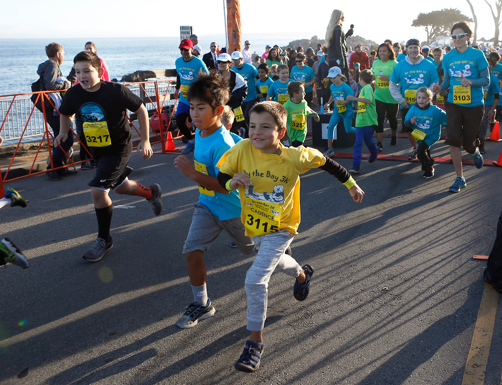 . Young runners take off at the start of the By the Bay 3K kids fun run at Lovers Point in Pacific Grove on Saturday November 11, 2017. (David Royal/Herald Correspondent)