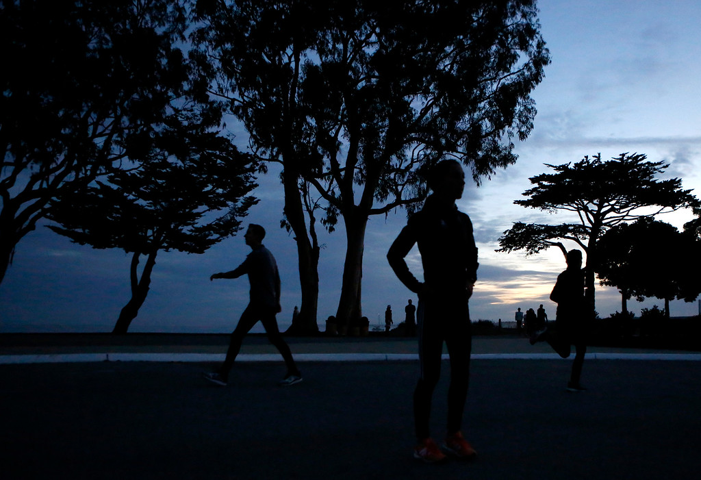 . Runners stretch out at Window on the Bay Park before the start of the Monterey Bay Half Marathon in Monterey, Calif. on Sunday November 12, 2017. (David Royal/Herald Correspondent)