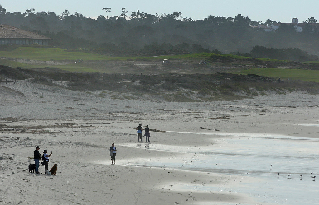 . People walk on Asilomar State Beach on Tuesday, Nov. 14, 2017.  (Vern Fisher - Monterey Herald)
