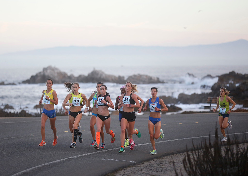 . Female lead runners pass Point Pinos during the Monterey Bay Half Marathon in Pacific Grove, Calif. on Sunday November 12, 2017. (David Royal/Herald Correspondent)