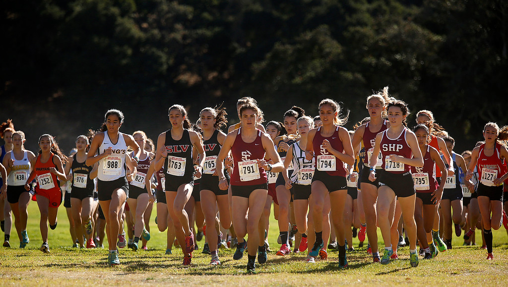 . Santa Cruz\'s Mari Friedman, center, (791), leads a group of runners at the start on her way to a win in the Girls Division V CCS Cross Country Finals at Toro Park in rural Salinas on Saturday November 11, 2017. (David Royal/Herald Correspondent)