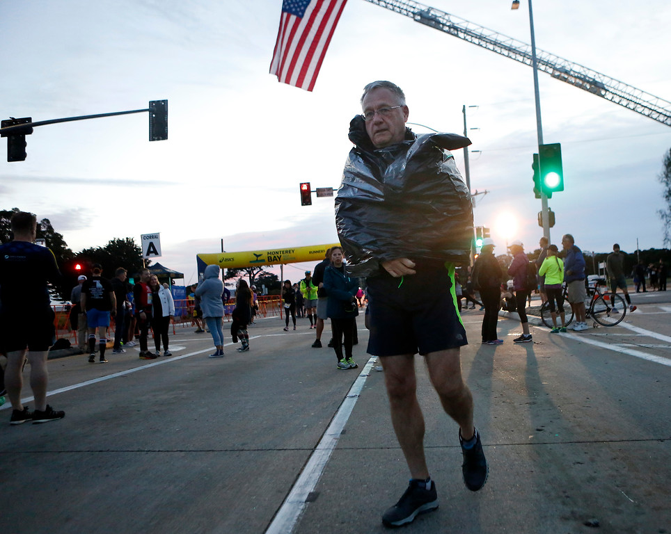 . Mike Gauvin of Coos bay Ore. wears a trash bag before the start of the Monterey Bay Half Marathon in Monterey, Calif. on Sunday November 12, 2017. (David Royal/Herald Correspondent)