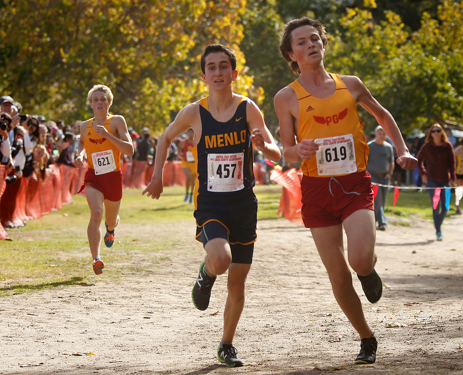 . Pacific Groves\' Henry Lot sneaks past a Menlo runner at the finish of the Boys Division IV CCS Cross Country Finals at Toro Park in rural Salinas on Saturday November 11, 2017. (David Royal/Herald Correspondent)