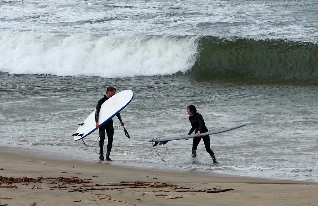 . Two surfers at Monterey State Beach on Thursday, Nov. 16, 2017.  (Vern Fisher - Monterey Herald)