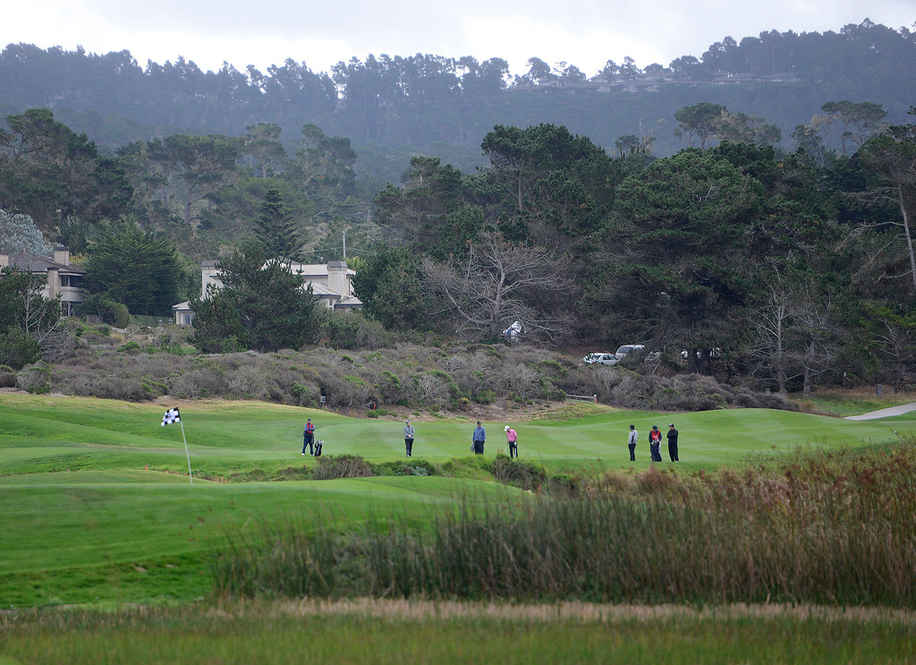 . Golfers battle the wind and rain at Spanish Bay Golf Course at the Taylor Made Pebble Beach Invitational on Thursday, Nov. 16, 2017.   (Vern Fisher - Monterey Herald)