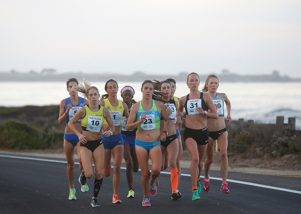 . Monicah Ngige, fourth from left, of Kenya runs with the lead pack of female runners on Oceanview Boulevard in Pacific Grove, Calif. on her way to winning the Monterey Bay Half Marathon on Sunday November 12, 2017. (David Royal/Herald Correspondent)