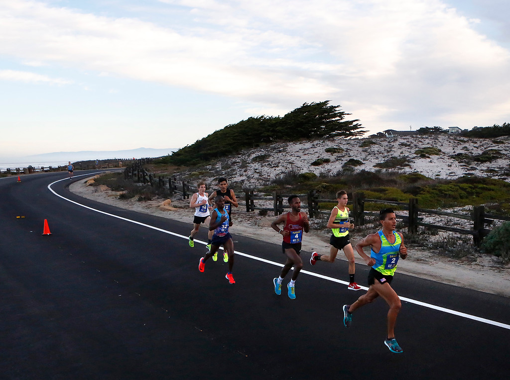 . Daniel Tapia, right, of Prunedale, Calif. leads the men past Asilomar State Park on his way to winning the Monterey Bay Half Marathon in Pacific Grove, Calif. on Sunday November 12, 2017. (David Royal/Herald Correspondent)
