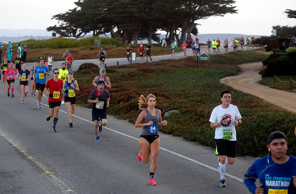 . Runners run along Ocean View Boulevard during the Monterey Bay Half Marathon in Pacific Grove, Calif. on Sunday November 12, 2017. (David Royal/Herald Correspondent)