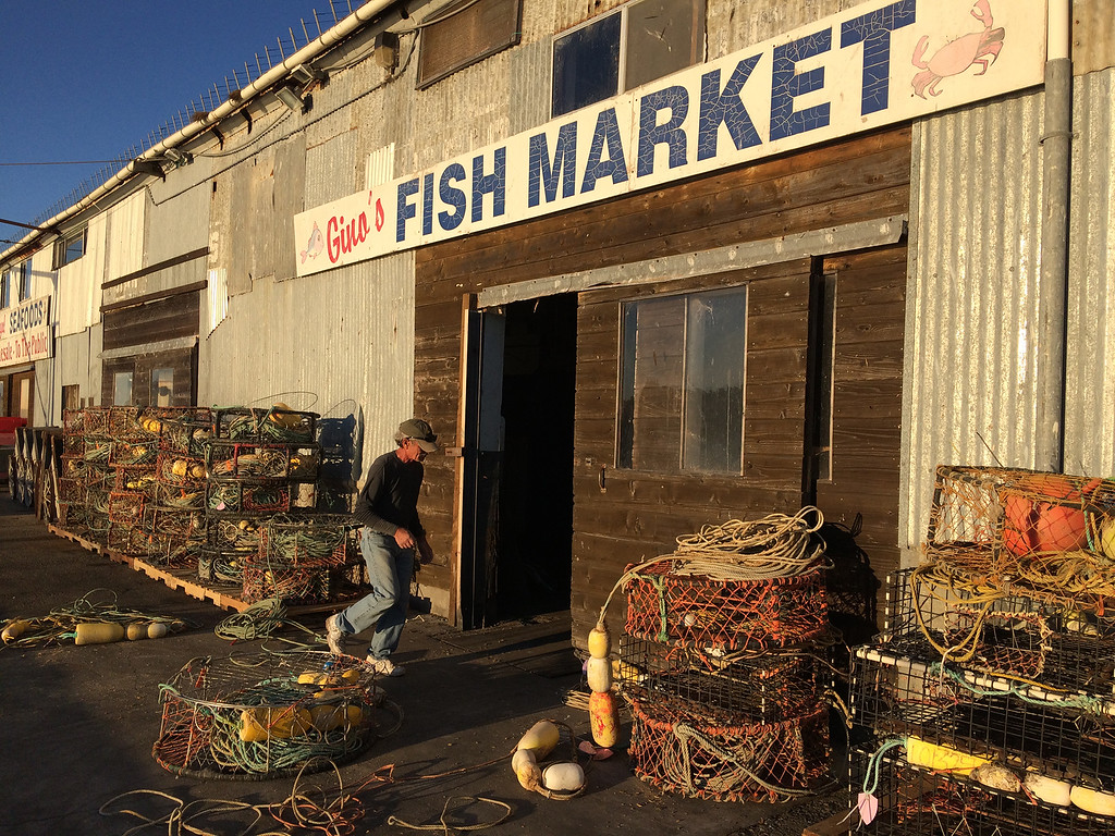 . Giovanni Nevoloso prepares crab traps for the upcoming commercial Dungeness crab season outside his business, Gino\'s Fish Market on Wharf No. 2 in Monterey on Tuesday November 7, 2017. Nevoloso owner the Gabbiano fishing boat and said he has been fishing for 60 years.  (David Royal/Herald Correspondent)