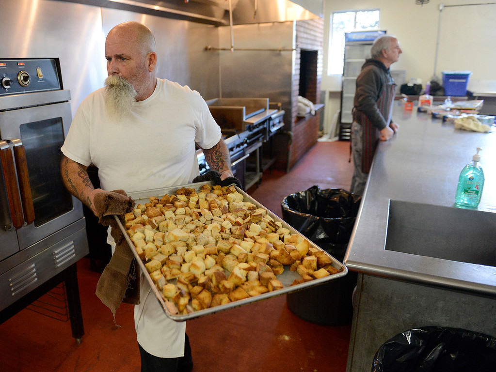 . Craig Stevens from Seaside helps prepare for the Thanksgiving Day Meal at the Monterey Fairgrounds on Wednesday, Nov. 22, 2017.  (Vern Fisher - Monterey Herald)