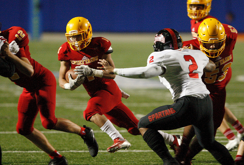 . Palma running back Anthony Villegas (1) scrambles for a gain in the first-half of their game against Seaside High during the CCS Open Division III football playoffs at Rabobank Stadium in Salinas on Friday, Nov. 17, 2017.  (Vern Fisher - Monterey Herald)