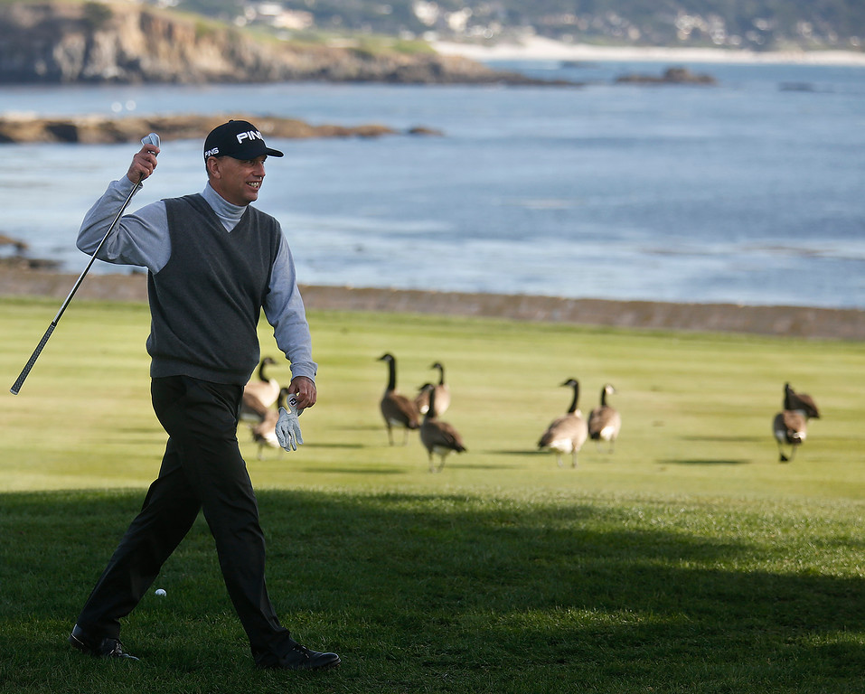 . Kevin Sutherland walks past a flock of geese before hitting his ball on the 18th green during the final round of the TaylorMade Pebble Beach Invitational golf tournament at Pebble Beach Golf Links on Sunday November 19, 2017. Sutherland finished tied for second at -6 after leading at the beginning of the day. (David Royal/Herald Correspondent)