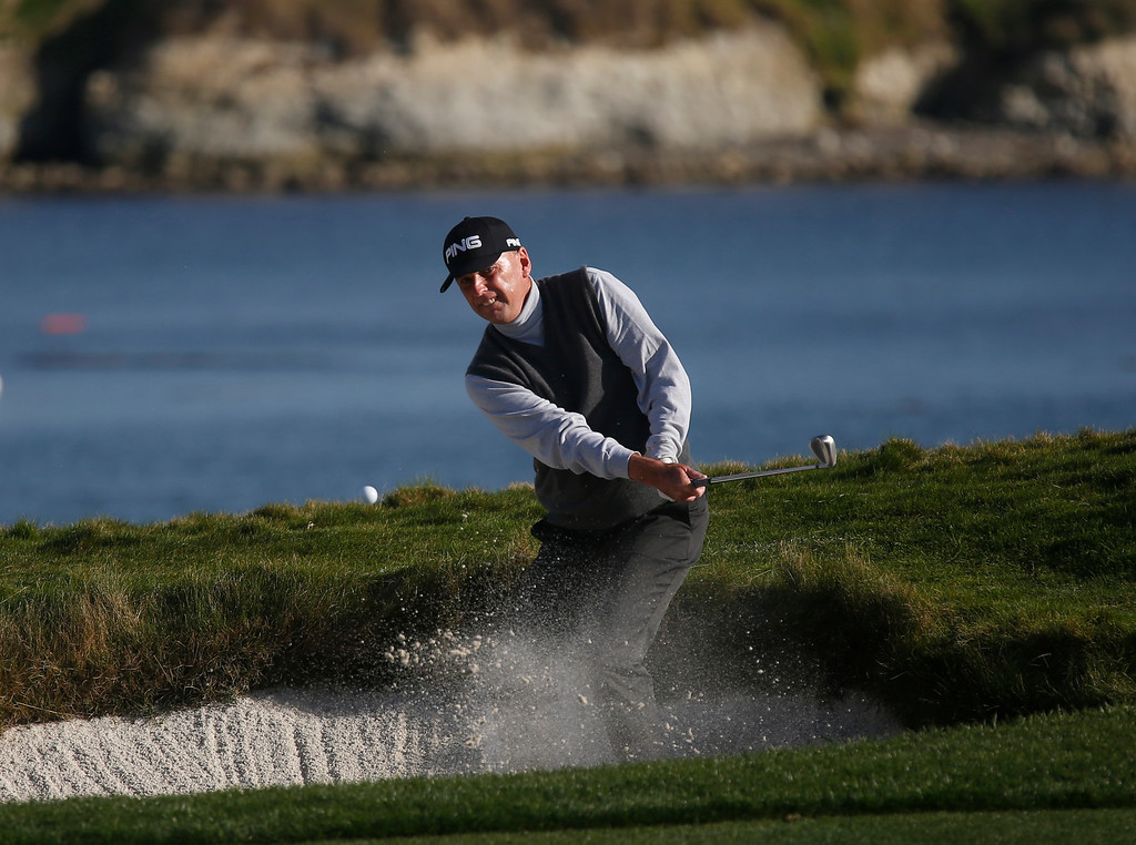 . Kevin Sutherland digs himself out of a sand trap on the 17th green during the final round of the TaylorMade Pebble Beach Invitational golf tournament at Pebble Beach Golf Links on Sunday November 19, 2017. Sutherland finished tied for second at -6 after leading at the beginning of the day. (David Royal/Herald Correspondent)