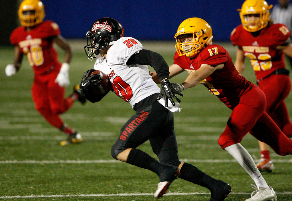 . Seaside\'s Daniel Sayre (20) avoids Palma\'s Nathan Leavitt (17) in the first-half of their game during the CCS Open Division III football playoffs at Rabobank Stadium in Salinas on Friday, Nov. 17, 2017.  (Vern Fisher - Monterey Herald)