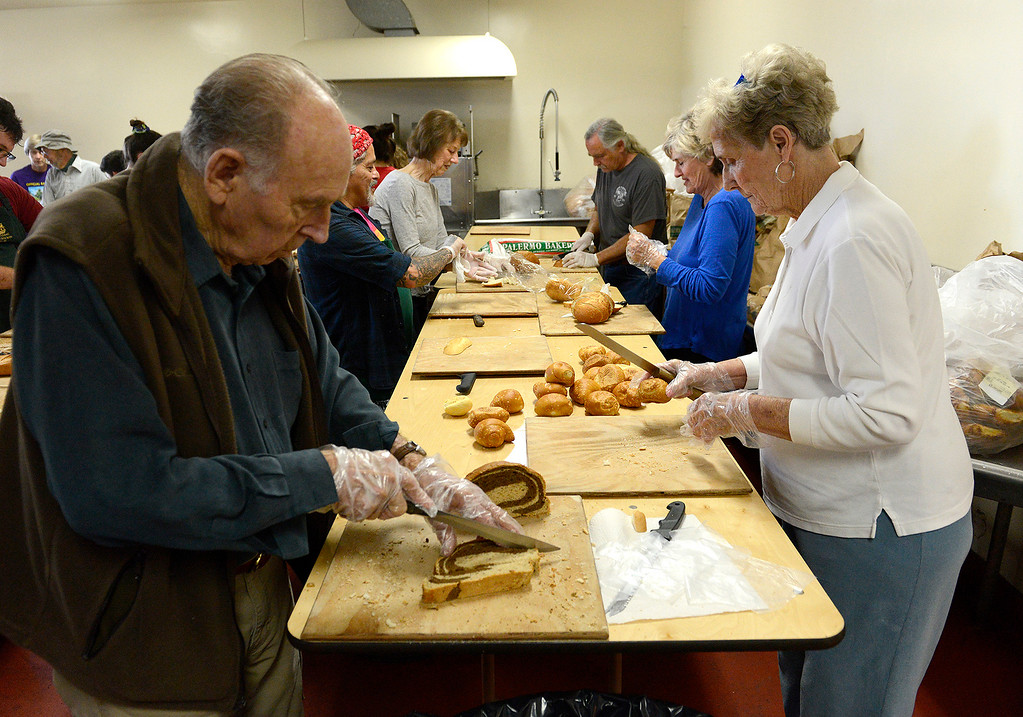 . Roy and Barbara Meazell from Pacific Grove volunteer with food preparation for the Thanksgiving Day Meal at the Monterey County Fairgrounds on Wednesday, Nov. 22, 2017.  (Vern Fisher - Monterey Herald)