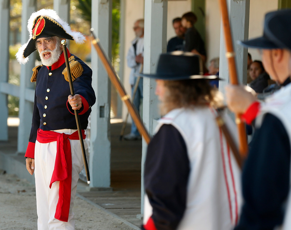 . Jose Rafael Ramos speaks to his soldiers while playing Governor Solo of Spain during a reenactment of the Battle of Monterey at Custom House Plaza in Monterey on Saturday November 18, 2017. (David Royal/Herald Correspondent)