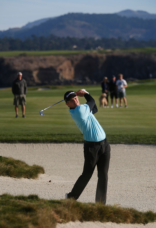 . Sam Burns hits his ball from a trap on the 18th fairway during the final round of the TaylorMade Pebble Beach Invitational golf tournament at Pebble Beach Golf Links on Sunday November 19, 2017. (David Royal/Herald Correspondent)