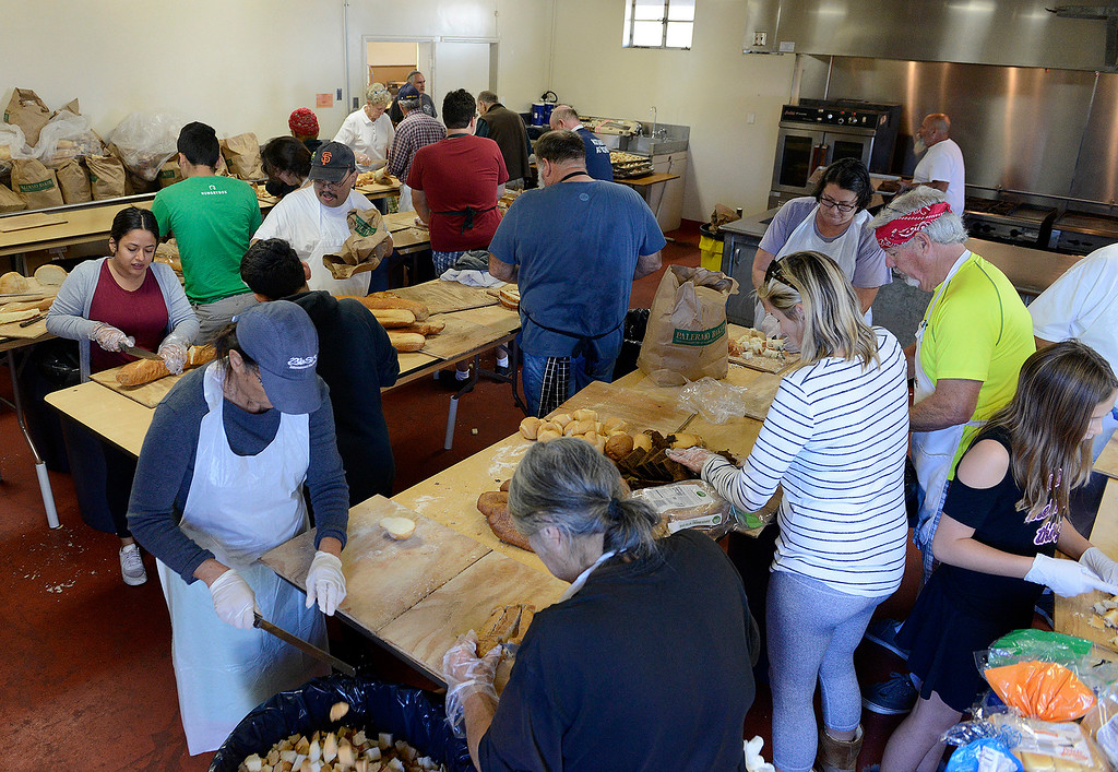 . Volunteers help prepare for the Thanksgiving Day Meal at the Monterey Fairgrounds on Wednesday, Nov. 22, 2017.  (Vern Fisher - Monterey Herald)