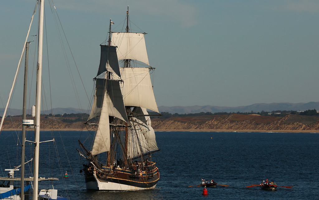 . Actors dressed as Argentinian privateers make row skiffs to shore from their sailing ship off the Monterey Harbor during a reenactment of the Battle of Monterey on Saturday November 18, 2017.  The boat\'s real name is The Lady Washington. (David Royal/Herald Correspondent)