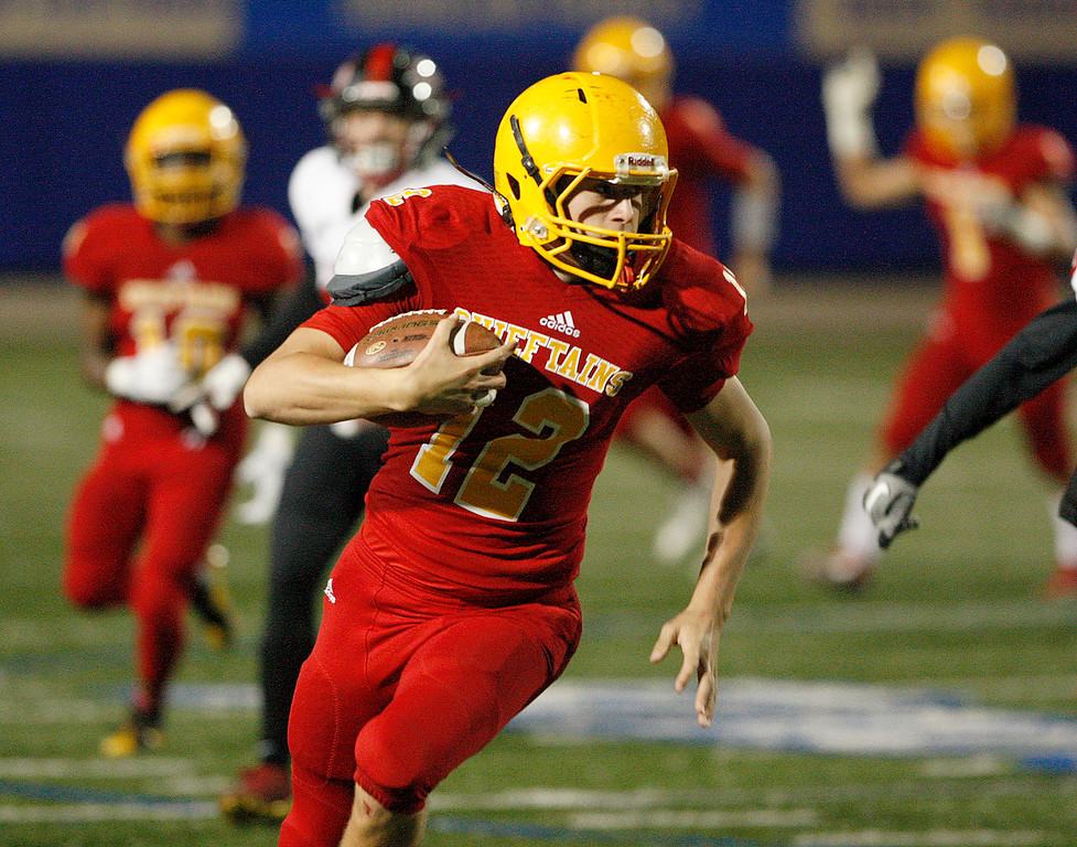 . Palma\'s Sam Lathos (12) scrambles for a gain in the first-half of their game against Seaside High during the CCS Open Division III football playoffs at Rabobank Stadium in Salinas on Friday, Nov. 17, 2017.  (Vern Fisher - Monterey Herald)