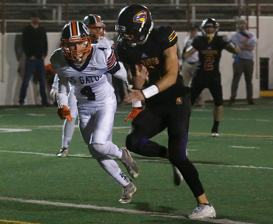 . Salinas quarterback Brett Reade runs in the second touchdown against Los Gatos during CCS playoff football at Salinas High School on Friday November 24, 2017. (David Royal/Herald Correspondent)