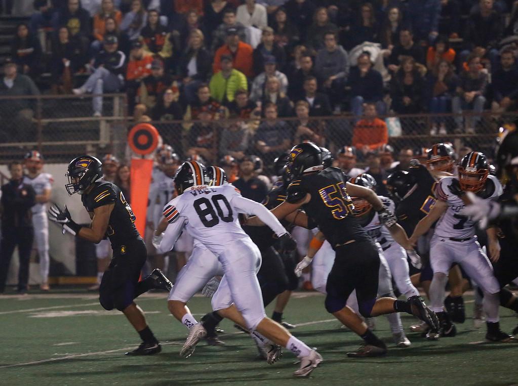 . Salinas\'s Richie Cerda breaks away for major yardage against Los Gatos during CCS playoff football at Salinas High School on Friday November 24, 2017. (David Royal/Herald Correspondent)