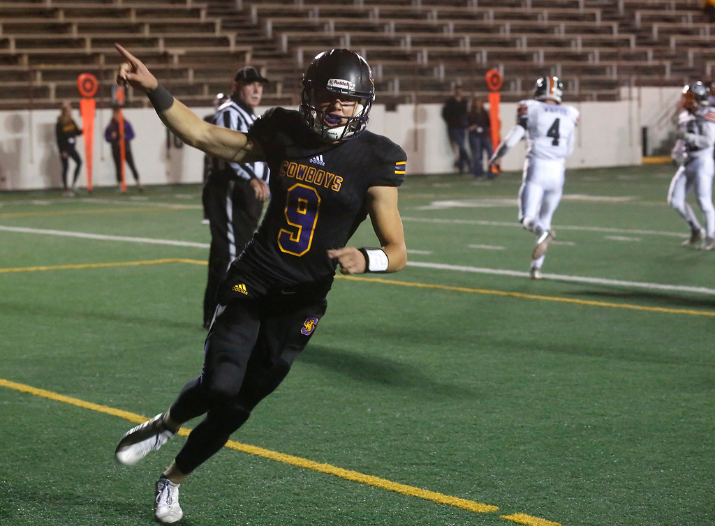 . Salinas quarterback Brett Reade celebrates after running in the first touchdown against Los Gatos\' during CCS playoff football at Salinas High School on Friday November 24, 2017. (David Royal/Herald Correspondent)