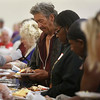 Harvey Byrum looks on as a volunteer pours gravy on his turkey during the Community Thanksgiving Dinner at the Monterey County Fair and Events Center in Monterey on Thursday November 23, 2017. (David Royal/Herald Correspondent)