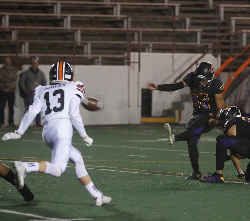 . Salinas\'s Adrian Hernandez kicks an extra point against Los Gatos during CCS playoff football at Salinas High School on Friday November 24, 2017. (David Royal/Herald Correspondent)