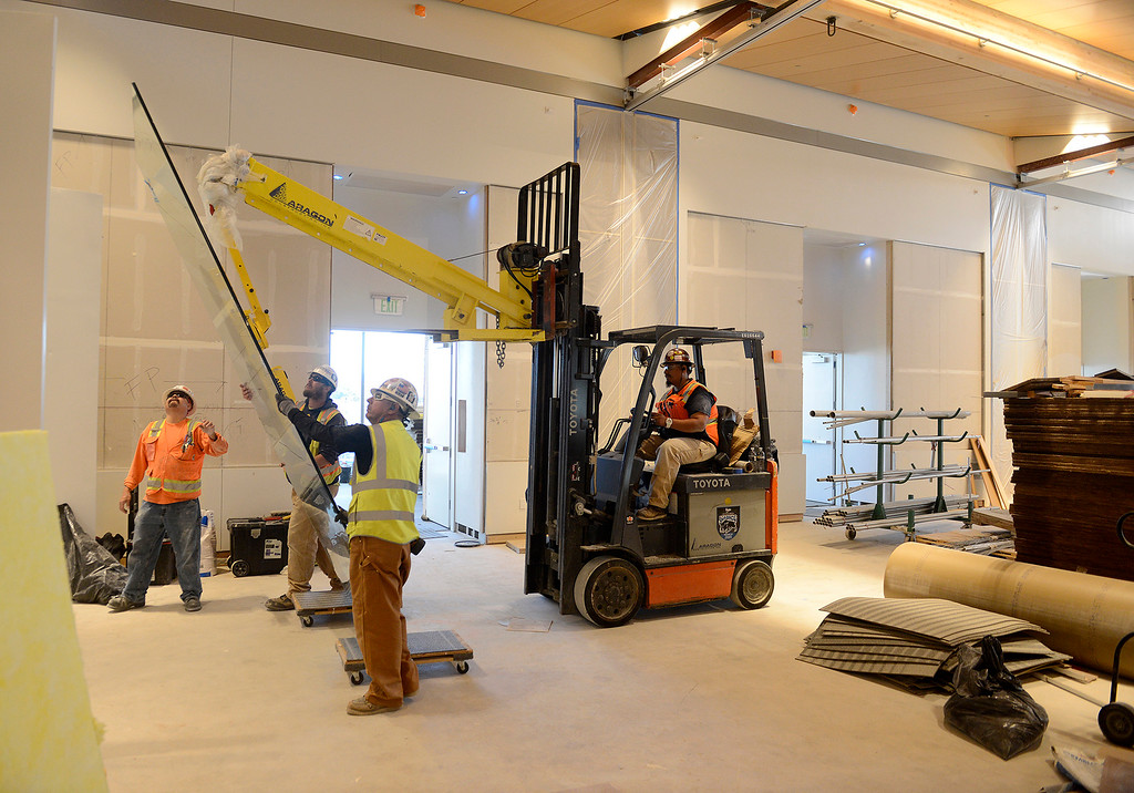 . Work crews transport a large piece of glass as construction contiunes on the Monterey Conference Center $60 Million renovation project on Tuesday, Nov. 28, 2017. The project will make 40,000+ square feet of Center meeting space with a 3,200 person total capacity once completed hopefully sometime soon.  (Vern Fisher - Monterey Herald)