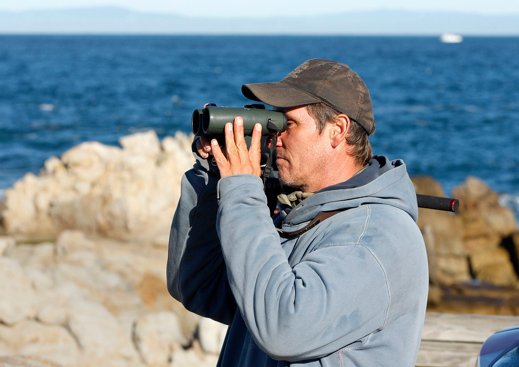 . Karl Bardon a field ornithologist from Minnesota uses high powered binoculars to view and count migrating birds at Point Pinos in Pacific Grove on Wednesday, Nov. 29, 2017.   (Vern Fisher - Monterey Herald)