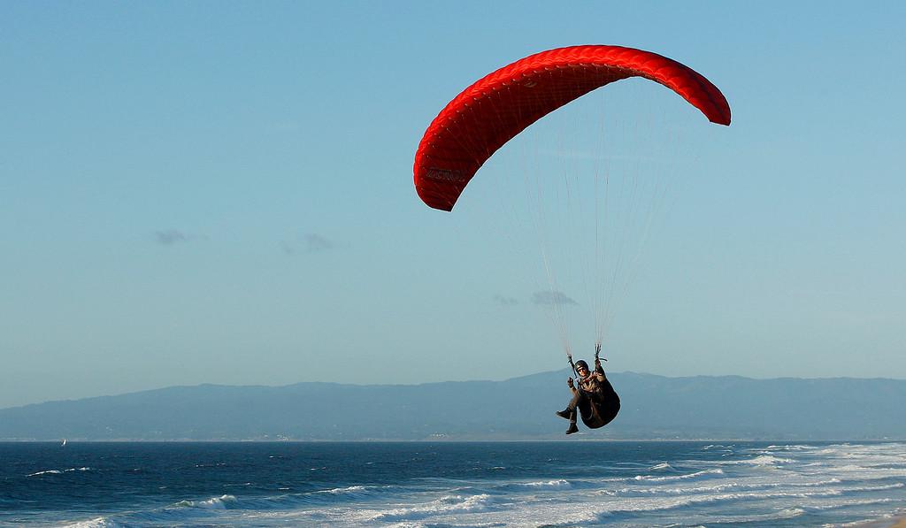 . A para sailor rides the wind off Marina State Beach on Monday, Nov. 27, 2017.  (Vern Fisher - Monterey Herald)