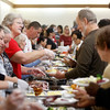 Volunteer Joan Hyler of Pacific Grove greets diners while serving turkey during the Community Thanksgiving Dinner at the Monterey County Fair and Events Center in Monterey on Thursday November 23, 2017. (David Royal/Herald Correspondent)