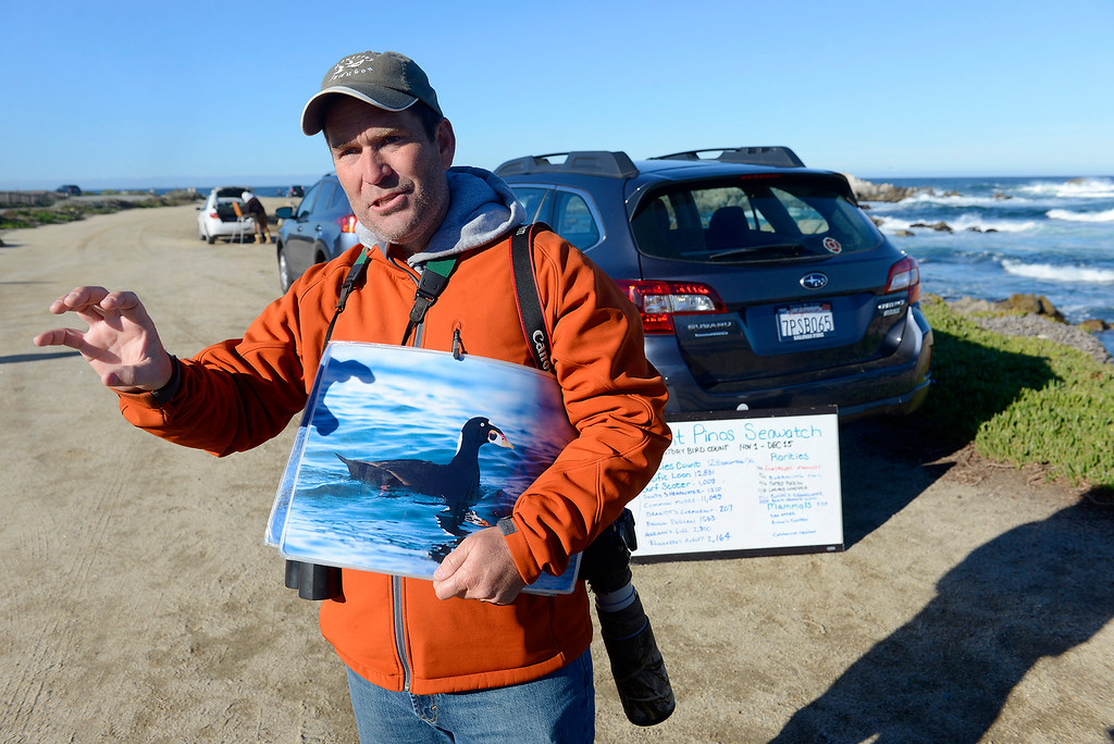 . Paul Fenwick with the Monterey Audubon Society counts migrating birds for the Point Pinos Seawatch on Wednesday, Nov. 29, 2017.   (Vern Fisher - Monterey Herald)