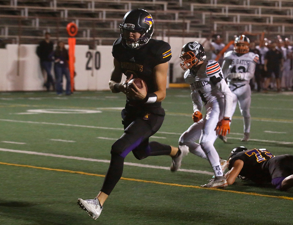 . Salinas quarterback Brett Reade runs in the first touchdown against Los Gatos\' during CCS playoff football at Salinas High School on Friday November 24, 2017. (David Royal/Herald Correspondent)