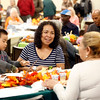 Vilma Jarquin and her son Josemaria Ortiz, 4, share their meal with friends during the Community Thanksgiving Dinner at the Monterey County Fair and Events Center in Monterey on Thursday November 23, 2017. (David Royal/Herald Correspondent)