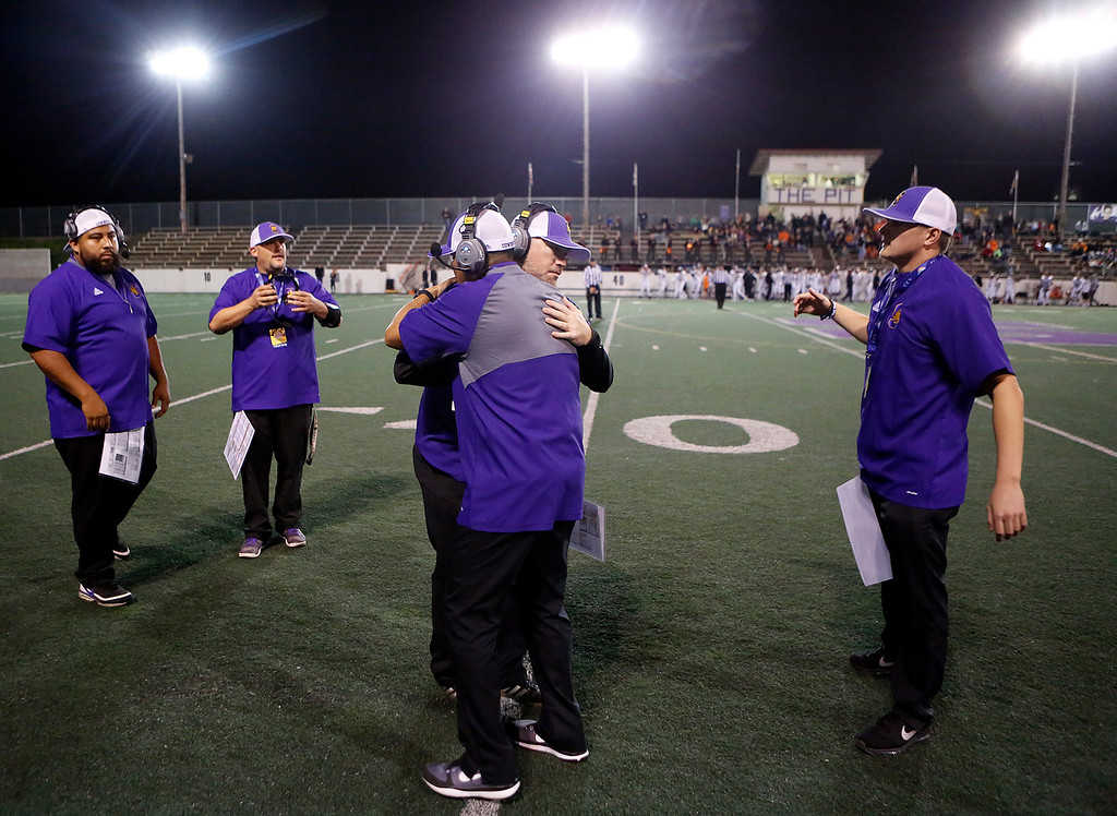 . Salinas coaches embrace before their team took the field against Los Gatos during CCS playoff football at Salinas High School on Friday November 24, 2017. (David Royal/Herald Correspondent)