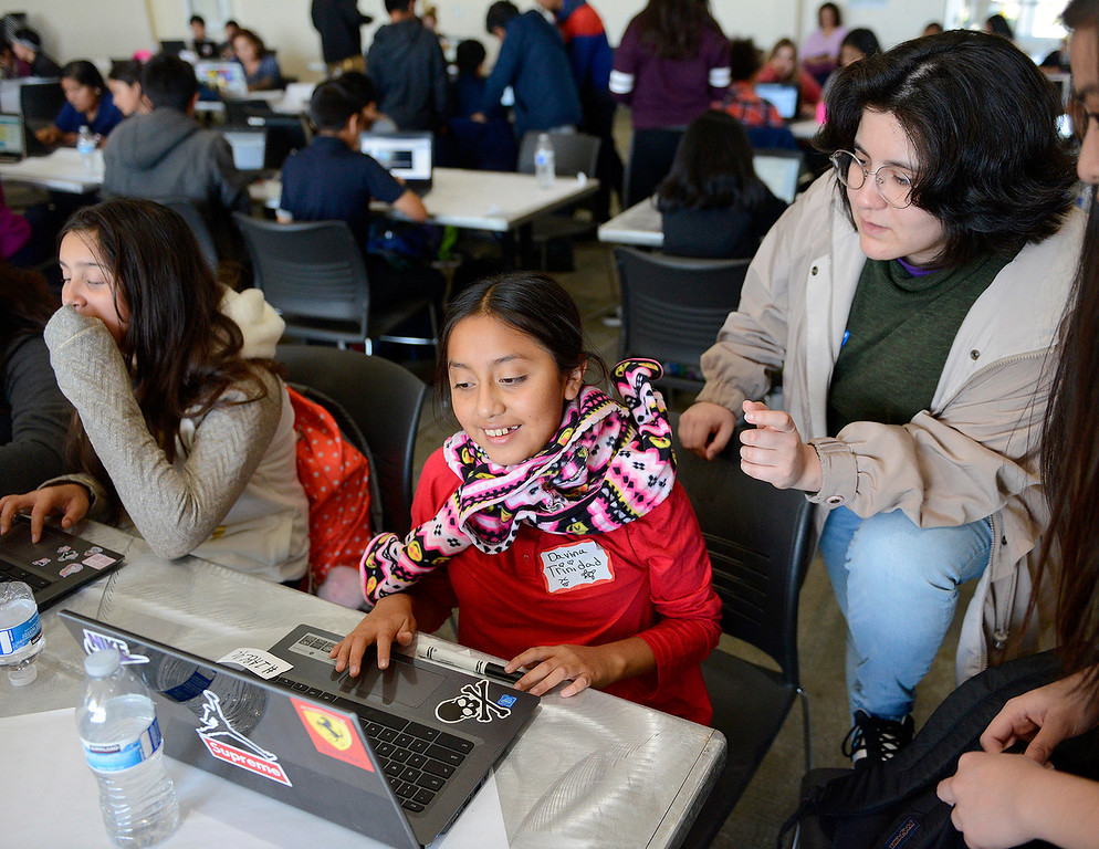 . Seaside Middle School sixth-grader Davina Trinidad, 11, gets help from Emily Garcia during the annual hackathon at CSU Monterey Bay on Tuesday, Nov. 28, 2017.  (Vern Fisher - Monterey Herald)