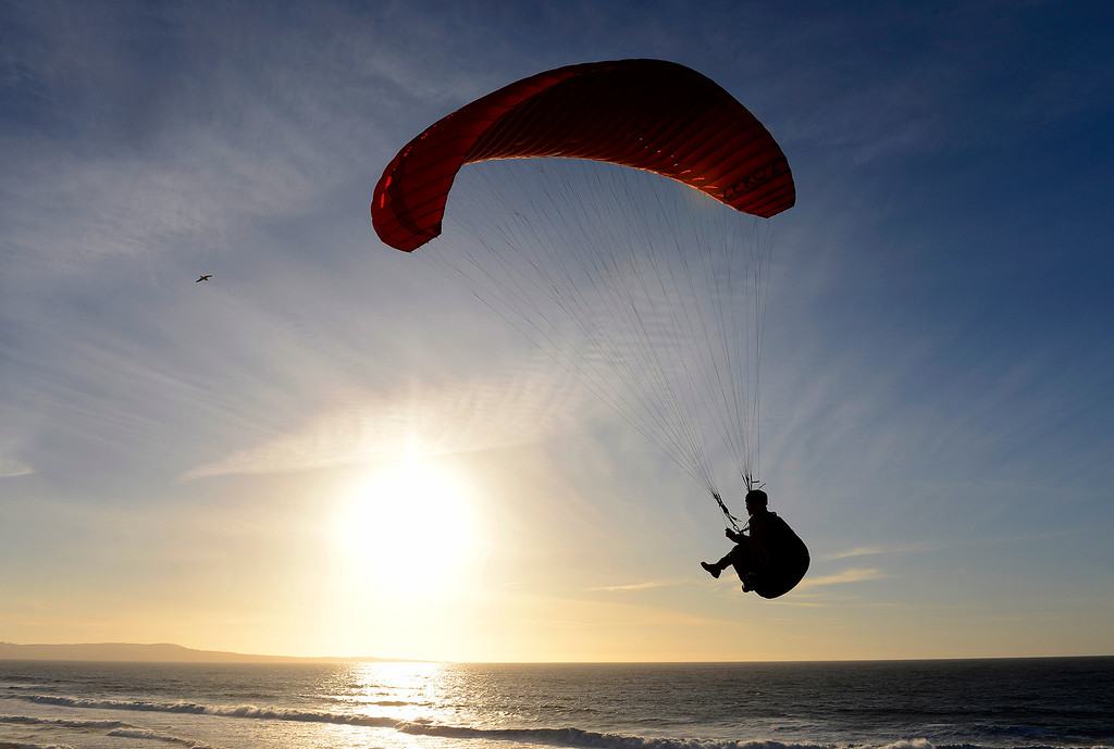 . A para sailor rides the wind off Marina State Beach on Monday, Nov. 27, 2017.  (Vern Fisher - Monterey Herald)