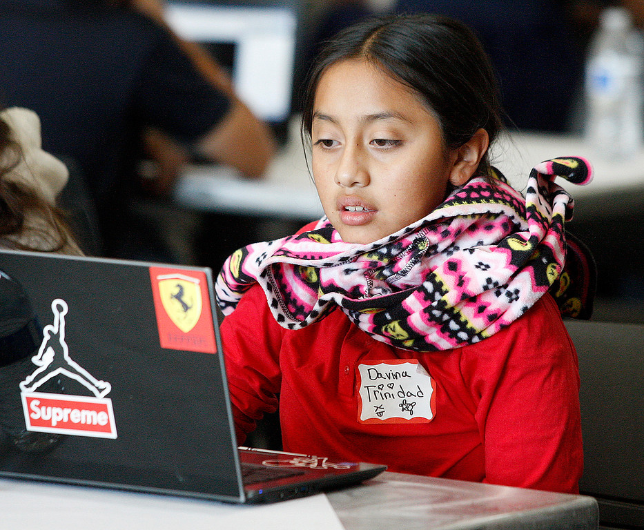 . Seaside Middle School sixth-grader Davina Trinidad, 11, during the annual hackathon at CSU Monterey Bay on Tuesday, Nov. 28, 2017.  (Vern Fisher - Monterey Herald)