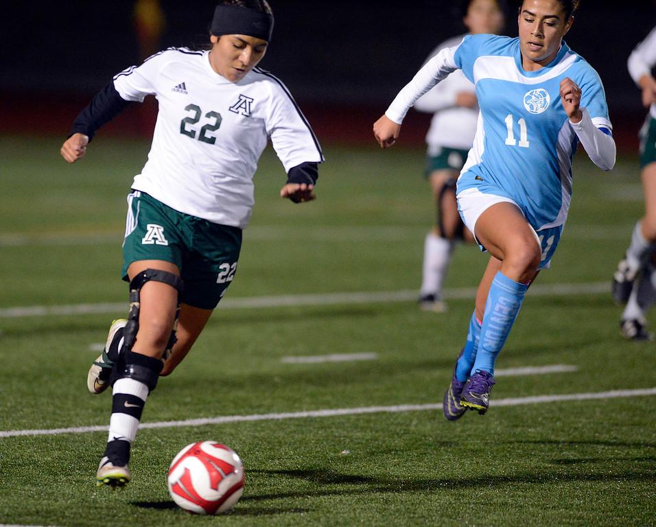 . Alisal\'s 22 moves the ball upfield against North Salinas\' Samantha Vargas during girls soccer at Alisal High School in Salinas on Thursday December 1, 2016. (David Royal - Monterey Herald)
