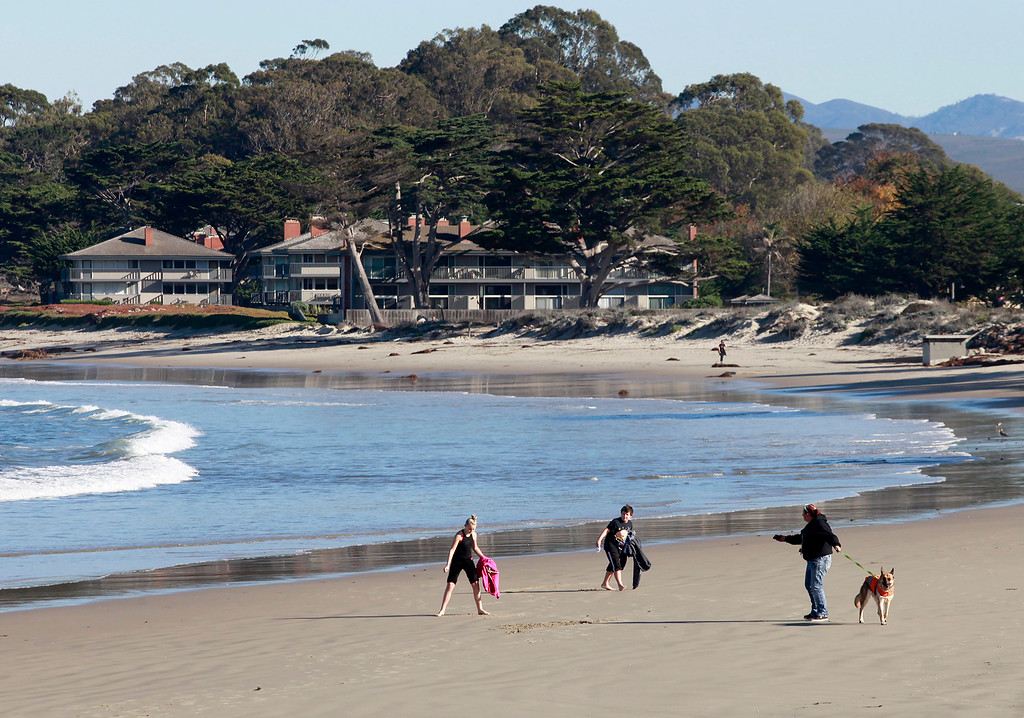 . People play on Del Monte State Beach in Monterey on a sunny Fall day on Tuesday, Nov. 29, 2016.  (Vern Fisher - Monterey Herald)