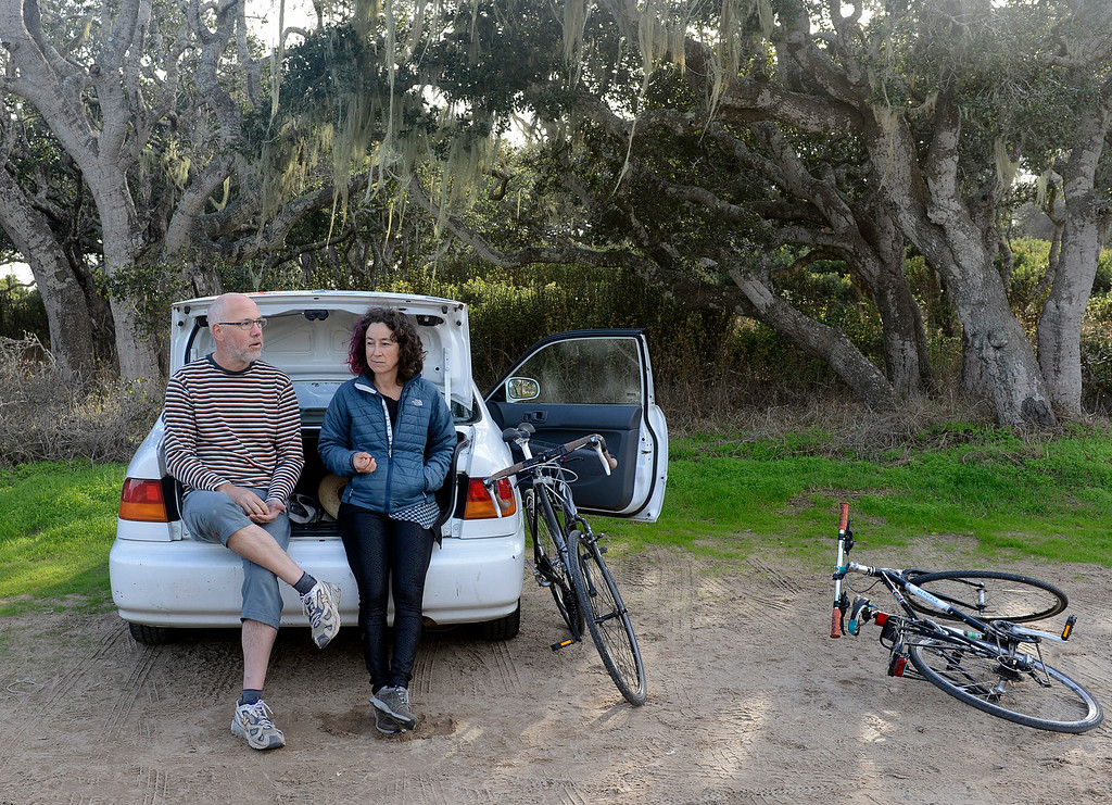 . Matt Jalbert and his friend Alma Martin eats snacks at the lot where cyclist and hikers gather at  Eighth Avenue and Gigling Road after a bike ride on the nearby roads on Fort Ord in Seaside on Friday November 25, 2016. (David Royal - Monterey Herald)