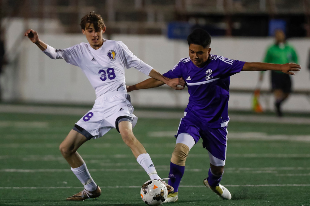 . Salinas\' Ronnie  McClean (38) tights to keep the ball away from Soledad\'s Oscar Ramirez during a non-conference CCS boys soccer game at Salinas High School on Tuesday, Nov. 29, 2016 in Salinas, Calif. (Vernon McKnight/Herald Correspondent)