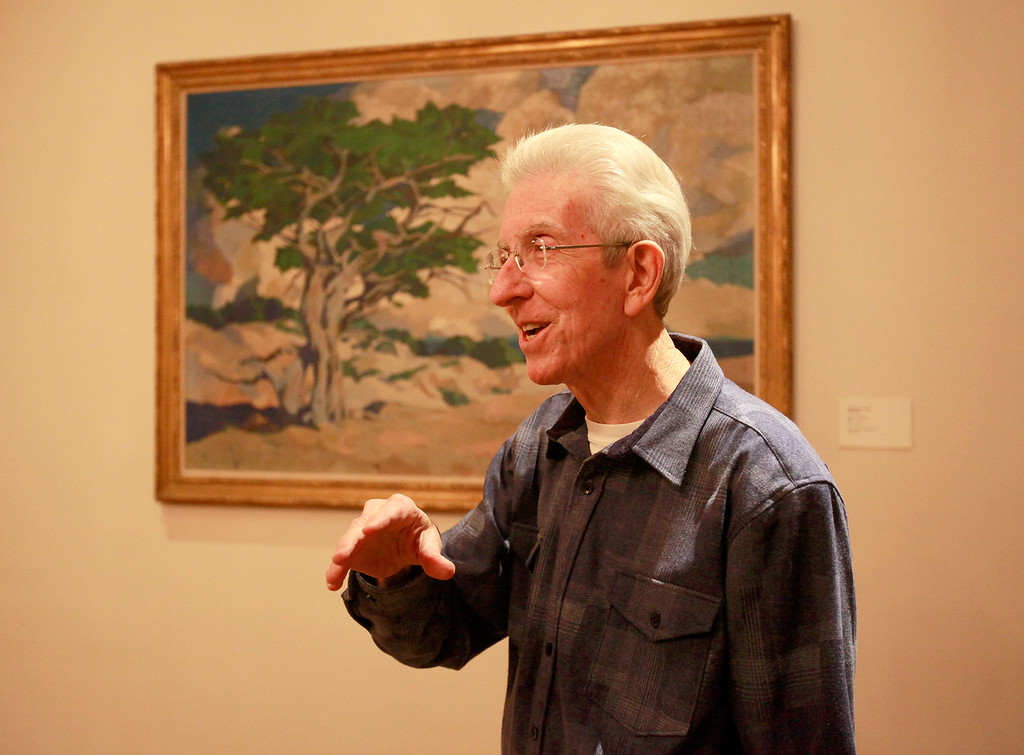 """. John Greenwald in front of a Frances McComas oil painting at La Mirada in Monterey on Tuesday, Nov. 29, 2016.  The discovery of original frescos and letters at La Mirada help tell the story of the pioneering Ruth Wightman Morris who is the subject of Monterey author John Greenwald\'s  book \""""Wild Bird\"""".  (Vern Fisher - Monterey Herald)"""